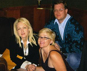 Cyndi and Mary Kay, with me  unaware I was in the shot, circa 2002.  The envelope under Ms Lauper's arm contains Fade.